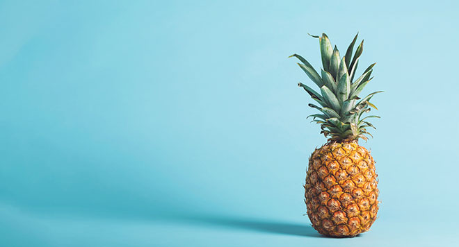 Pineapple against blue background