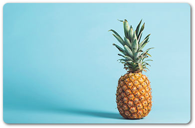 Image of a pineapple against blue background